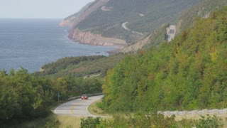 Car Driving Along Scenic Coastal Highway