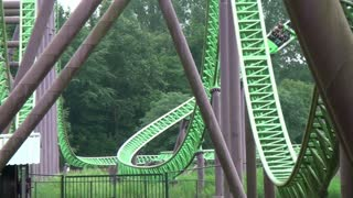 Car Flies by Camera on Green and Purple Coaster