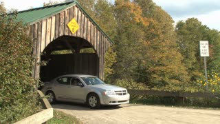 Car Going Under Covered Bridge