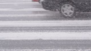 Car Wheels Zooming by on Snowy Highway