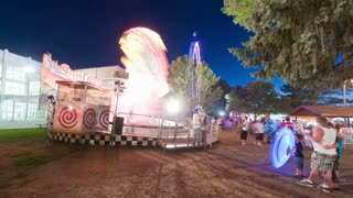 Carnival twist ride with time lapse