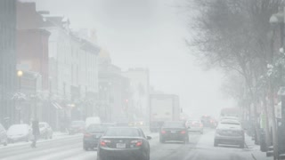 Cars and Pedestrians on Snowy DC Street