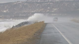 Cars Driving Down Homer Spit Road During Storm