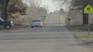 Cars Driving on Rural Neighborhood Road