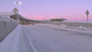 Cars Driving Through Airport Terminal