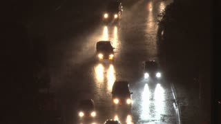 Cars Driving With Pouring Rain