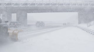 Cars on Highway in Snowstorm
