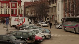 Cars Parked Along Romanian City Street