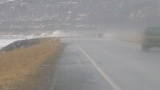 Cars Trying to Drive Down Homer Spit Road in Alaska During Storm