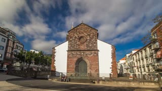 Catholic church in Funchal, Madeira island, Portugal timelapse hyperlapse with blue cloudy sky at sunny day 4K