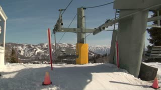 Chairlift Lets Skiiers Off At Top Of Hill