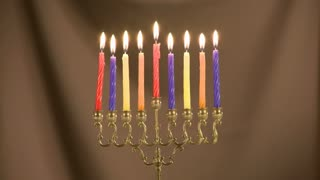 Chanukkah items menorah, lit candles