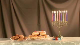 Hanukkah items jewish holyday with menorah, candles, donuts