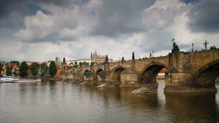 Charles Bridge (Karluv Most) Prague, Czech Republic, with St. Vitus Cathedral and the Castle district in the  background -T/Lapse