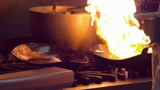 Chefs Cooking Over Flame in Kitchen 2