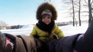 Child is riding on a sledge