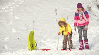 Child learning to ride a skis