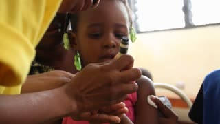 Child Receives Fingernail Mark After Vaccination In Haiti