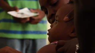 Child Receives Vaccine Shot In Haiti