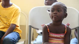 Child Waits For Dr At Vaccination Clinic