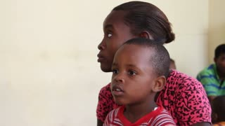 Child Waits For Vaccination In Haiti