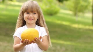 Child with a melon