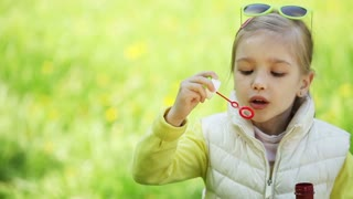 Child with soap bubbles outdoors