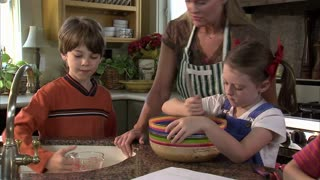 Children Help Their Mother Mix Ingredients 11