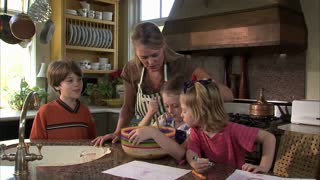 Children Help Their Mother Mix Ingredients 12