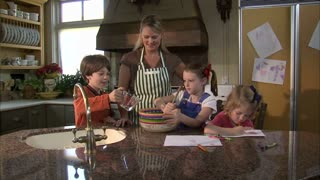 Children Help Their Mother Mix Ingredients 2