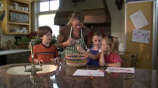 Children Help Their Mother Mix Ingredients 3