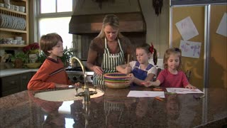 Children Help Their Mother Mix Ingredients 4