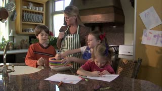 Children Help Their Mother Mix Ingredients