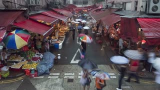 China, Hong Kong, Central, busy street market on a rainy afternoon