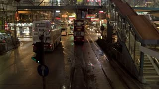 China, Hong Kong, Central, POV Tram on busy city streets at night