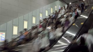 China, Hong Kong, WS People moving on a busy escalator, T/L
