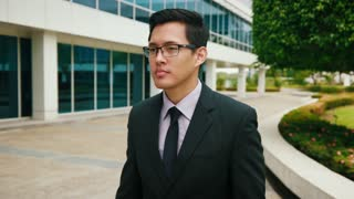 Chinese Businessman Commuter Walking To Office Building