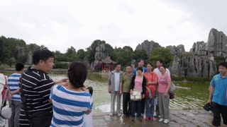 Chinese Tourists Taking Photo by Lake