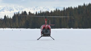 Chopper Lifting Off From Snow