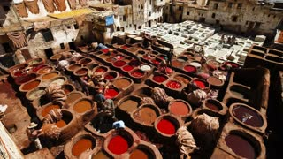 Chouwara traditional leather tannery in Old Fez, vats for tanning and dyeing leather hides and skins, Fez, Morocco, North Africa, T/Lapse