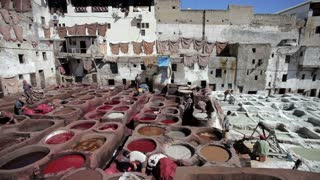 Chouwara traditional leather tannery in Old Fez, vats for tanning and dyeing leather hides and skins, Fez, Morocco, North Africa