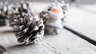 Christmas scene with fir cones and Santa Claus
