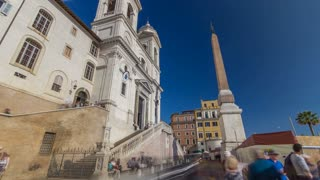 Church of Trinita dei Monti and Egyptian obelisk timelapse hyperlapse in Rome in Italy. It is a Roman Catholic and Renaissance church near the Spanish Steps leading to the Piazza di Spagna, that is