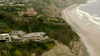 Circle Around Houses On Beach Cliffs