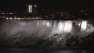 City Skyline Behind Niagara Falls at Night