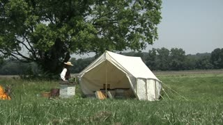 civil war era man working around tent