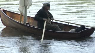 civil war era slave escapes on rowboat with captain