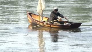 civil war era slave pops up on rowboat in lake