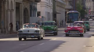 Classic Cars With Happy Tourists On The Road In Havana