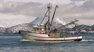 Classic Fishing Boat By Snowcapped Mountains